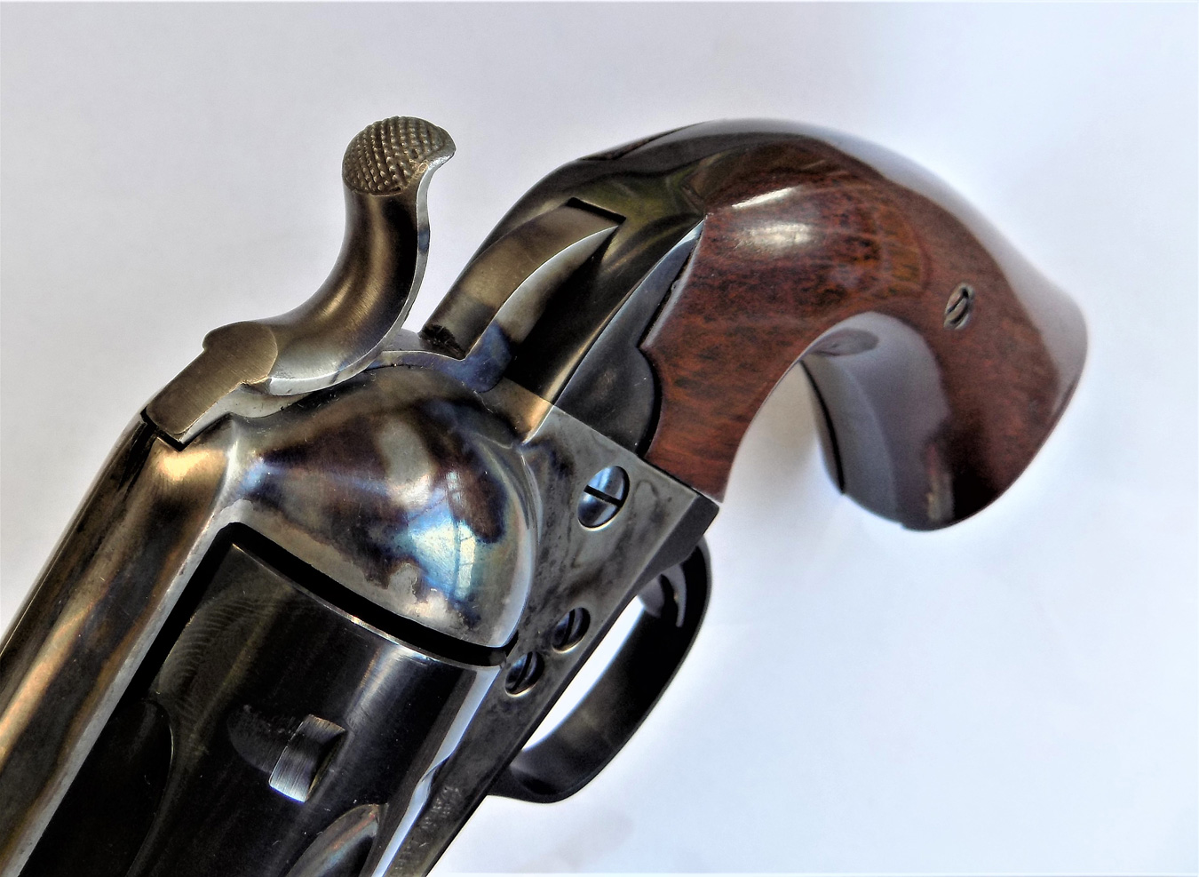 checkered hammer spur on a revolver