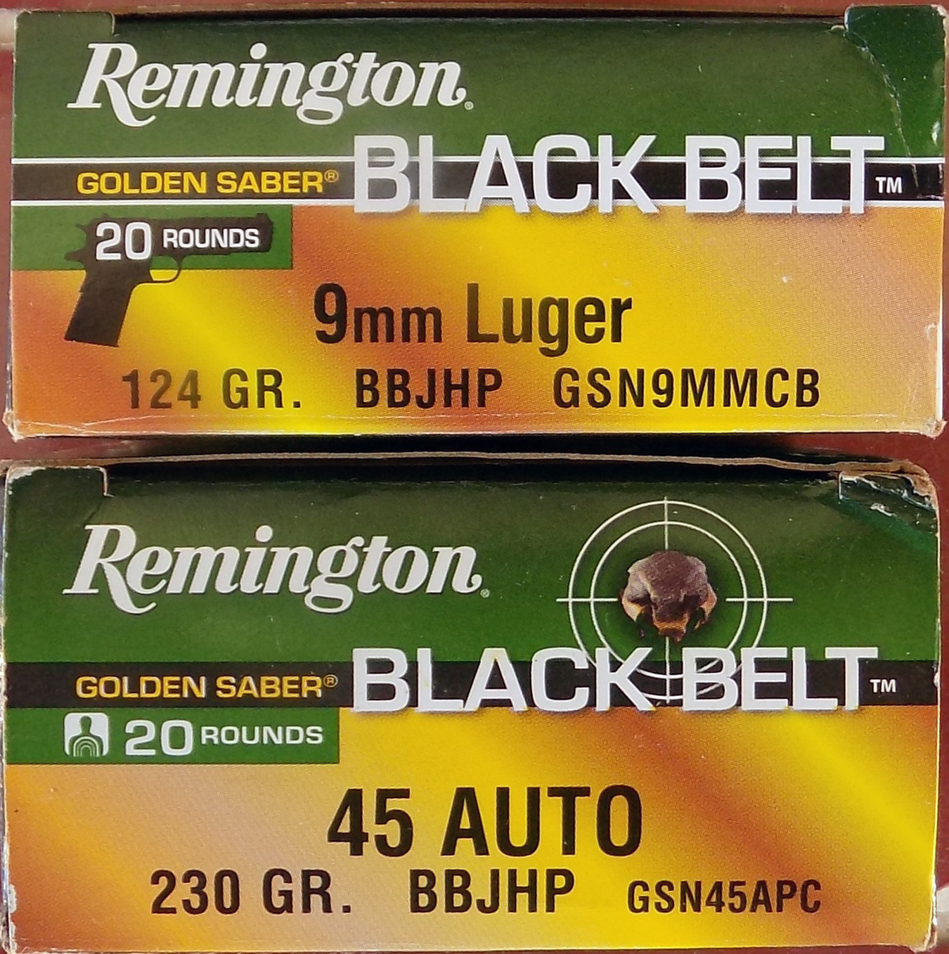 Two Remington Black Belt green and yellow ammunition boxes