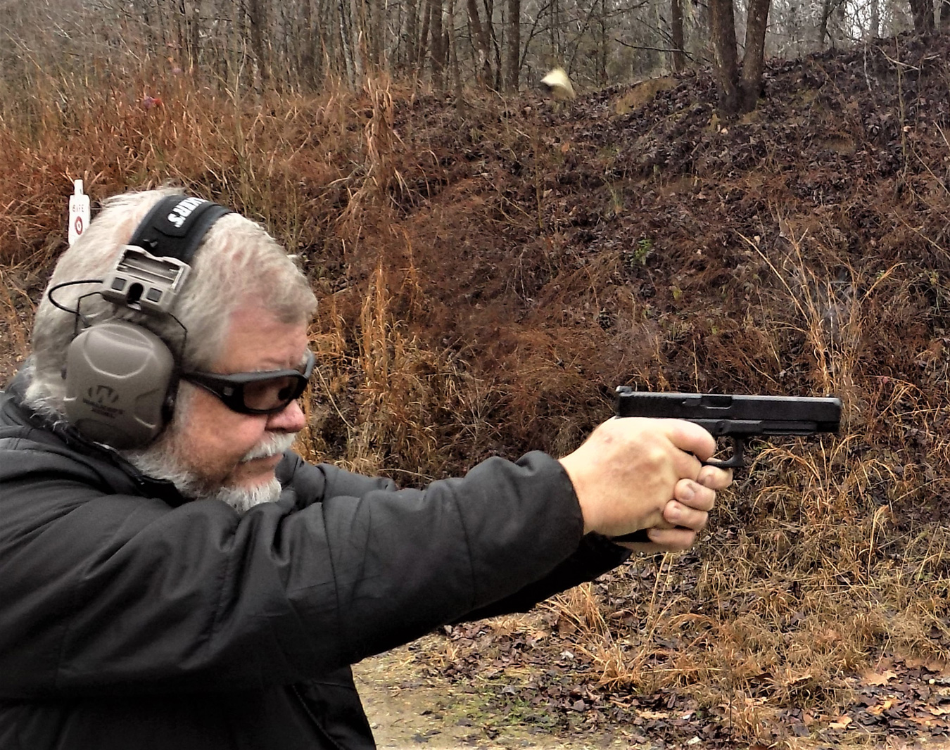 Bob Campbell shooting the SIG M17 pistol with a cartridge in the air