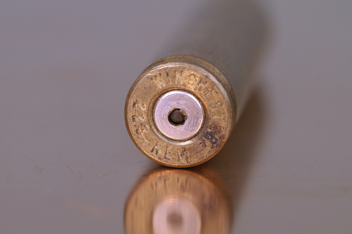 .223/5.56 cartridge with a primer that has a hole punched in it by the firing pin