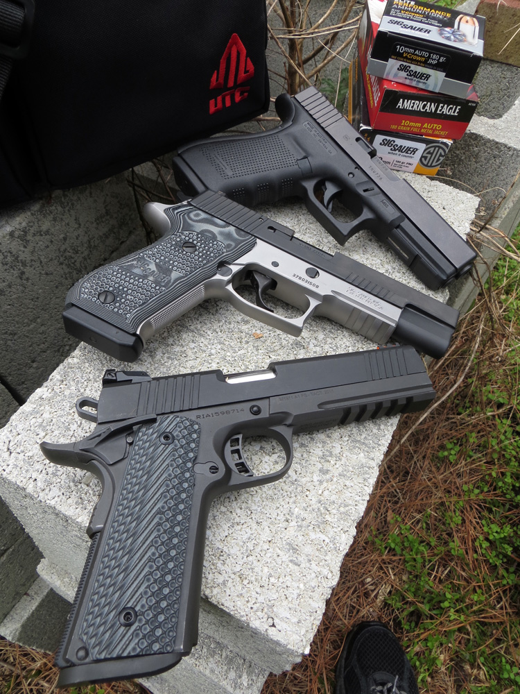 Glock G20 Gen4 (top or right), the SIG Sauer P220-10 Match Elite (middle) and the RIA Tac Ultra FS (bottom or left)